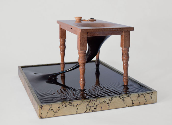 Sculpture of a table linked to the earth called Ouroboros by Bourdon Brindille